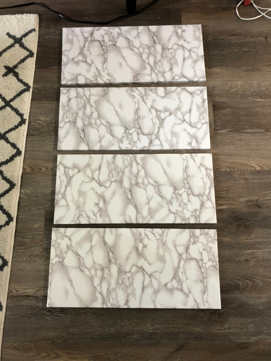 marble contact paper added to shelves
